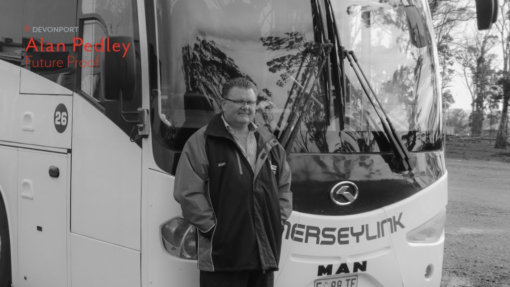 Alan Pedley of Merseylink stands in front of one of his buses